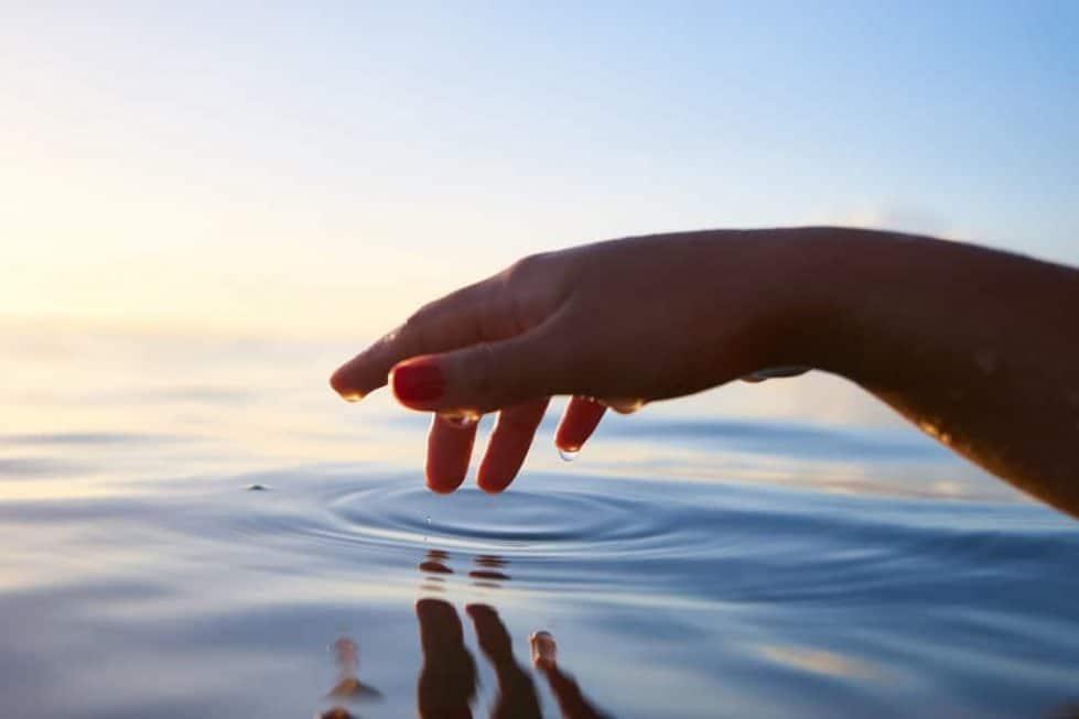 woman touching water